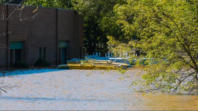 This office space was flooded on Durham Street near the intersection with Tryon Road in Raleigh on Sunday, Oct. 9, 2016. These are utility vans stuck in the water. Witnesses said the water was up to the awnings at the peak of the storm. (Photo By: Nick Stevens/WRAL)