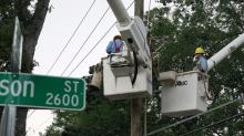 IMAGES: Power restored to 900k but tens of thousands remain in the dark