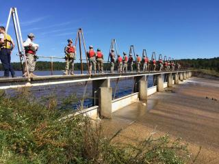 Members of the N.C. National Guard help sandbag the Wood Lake dam near Vass on Oct. 11, 2016, to shore up the weakened structure. (Photo by Ken Smith/WRAL)