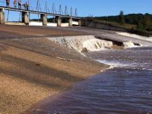A growing hole in the spillway of Wood Lake dam near Vass prompted an emergency evacuation of homes downstream on Oct. 10-11, 2016. (Photo by Ken Smith/WRAL)