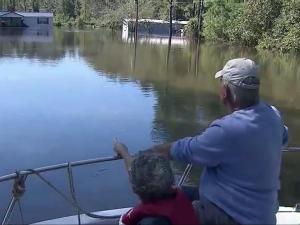 A boat is needed to access the Mossy Log neighborhood in southern Sampson County after flooding from Hurricane Matthew.