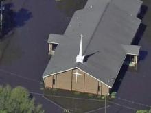 Sky 5 flies over flood damage