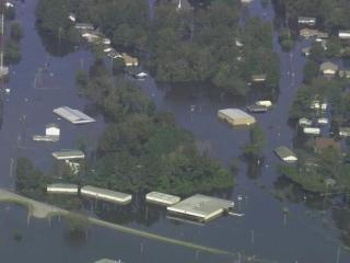 Sky 5 flies over flooded Princeville