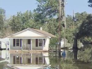 Water on Sunday was still surrounding homes in Seven Springs, a town that lost nearly half of its residents following Hurricane Floyd.