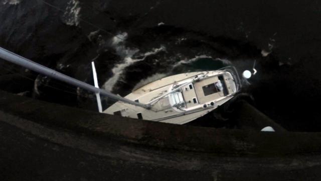 Florence slams sailboat against bridge