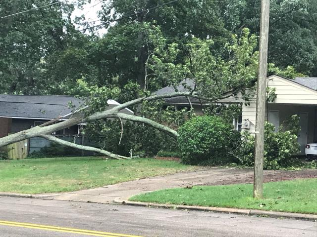 High winds blew out a transformer, downed trees and damaged a parking deck at Raleigh's Cameron Village shopping center. Photos posted to Twitter by @ThomasCecilRoss