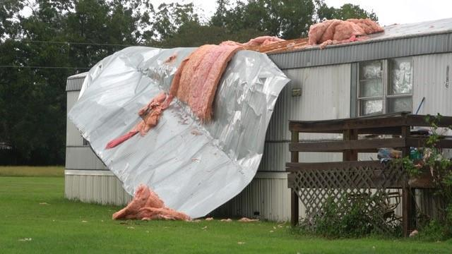 Winds have ripped the roof off of a mobile home in Clayton