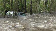 IMAGES: Driver dies when SUV is washed away