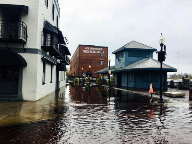 Water Street in downtown Wilmington was already underwater even before the Cape Fear River crests on Sept. 24, 2018, following Hurricane Florence.<br/>Photographer: Amanda Lamb