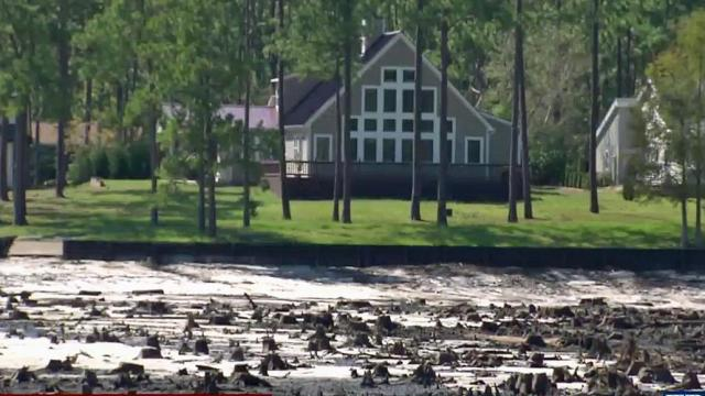Dam breaches empty Brunswick County lake :: WRAL com