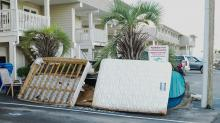 IMAGES: Two weeks later, cleanup underway in Carolina Beach and Wilmington