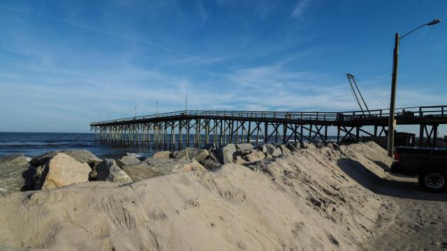The beach sand breeched the dunes and boulders near Carolina Beach Pier and it was bulldozed back to the boulders.    The North Carolina coast 2 weeks after Hurricane Florence made landfall around Wilmington, Leland and Carolina Beach.  Photo credit: Suzie Wolf