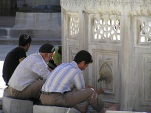 Observant Muslims pause for a few minutes at dawn, noon, mid-afternoon, sunset and nightfall daily to wash according to ritual, face in the direction of Mecca and recite certain prayers.