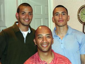 Dan Bowens, on the right, poses for a photo with his brother, Ben, and stepdad Byron Pitts.