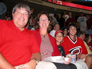 Jan Sharp enjoys a Carolina Hurricanes game with her husband, Ed, and their boys Chas (far right) and Hunter.