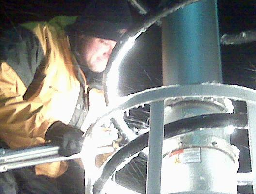 WRAL photographer Jamie Munden tries to melt ice off a live truck with a light.
