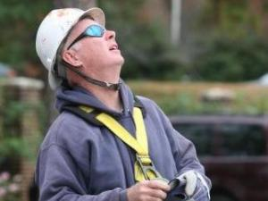 Professional climber Murray Adams prepares to climb WRAL's 300-foot tower.