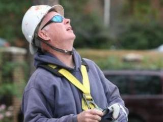 Professional climber Murray Adams prepares to climb WRAL's 300-foot tower.
