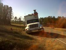 A tractor helped pull this WRAL truck out of a ditch on Jan. 6, 2012. (Photo by Tara Lynn)