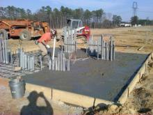 See photos of the solar farm being constructed, starting with site preparation through completion.