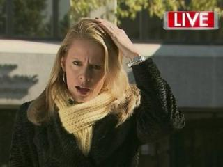 WRAL reporter Amanda Lamb reacts after an acorn hit her in the head during a live shot in Raleigh on Nov. 8, 2012.