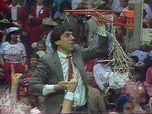 N.C. State Coach Jim Valvano cuts down the net after the 1983 championship.