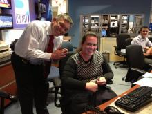 WRAL chief meteorologist Greg Fishel thanks assignment editor Kelly Riner as she sews on his button that popped off during a newscast on Friday, Dec. 14, 2012.
