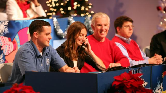 Volunteers answer phones at WRAL's 25th annual Coats for the Children telethon on Dec. 13, 2013.