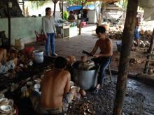 Along the Mekong River, the flesh and juice of the coconut are removed and the shells transformed into building material.
