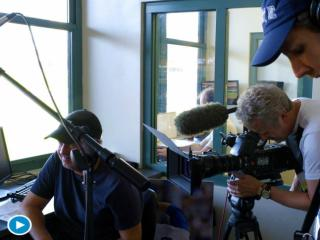 The WRAL Doc team works in the pressbox at Durham Bulls Athletic Park.