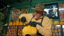 IMAGES: Carver creates 'O'Fishel' pumpkin at State Fair