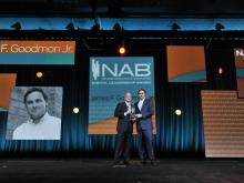 NAB Executive Vice President Sam Matheny presents first-ever NAB Digital Leadership Award to James F. Goodmon Jr. on April 15, 2015 at NAB Convention in Las Vegas.