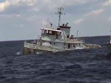 RAW: Tugboat slips into the Atlantic