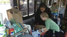 IMAGES: Here to Help: Donations come in for GoTriangle Storm Relief Bus