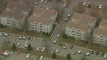 Dozens of law enforcement officials responded to a condominium complex in Raleigh Wednesday, Nov. 30, 2016, after a police officer was injured in a shooting. A suspect was also shot in the incident. Both were taken to WakeMed.
