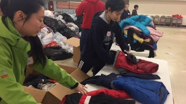 Volunteers at the Salvation Army spent the Martin Luther King Jr. holiday sorting winter wear donated through WRAL's annual Coats for the Children campaign.