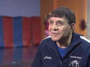Acclaimed wrestling coach still on the mat at 65