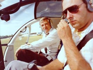 WRAL Anchor Charlie Gaddy with SKY 5 pilot Randy Watkins.