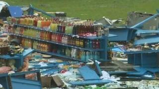 Bottles on shelf remain 'untouched' after storm
