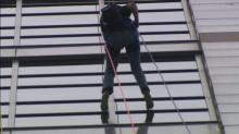 IMAGES: Meteorologist battles fear of heights with rappel from Raleigh skyscraper